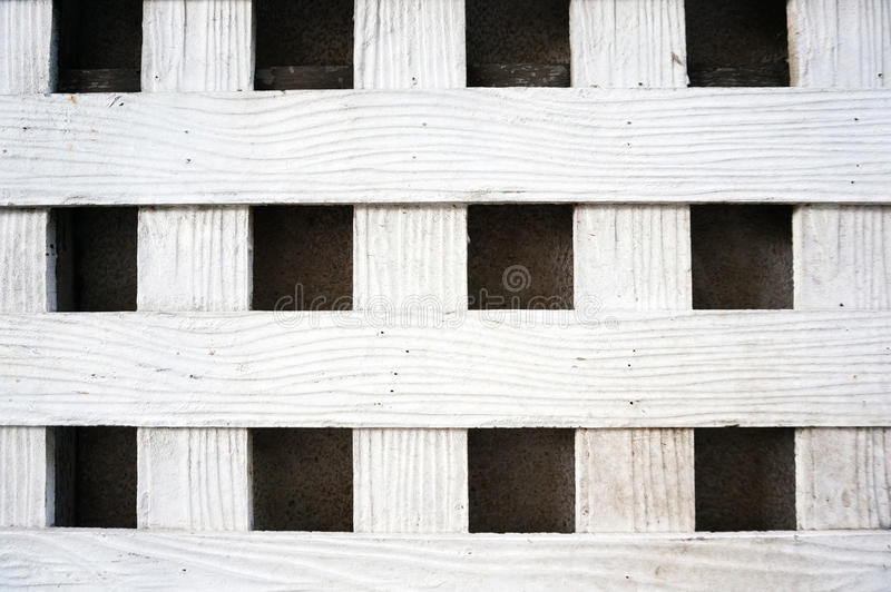 White wood lath on cement wall royalty free stock image