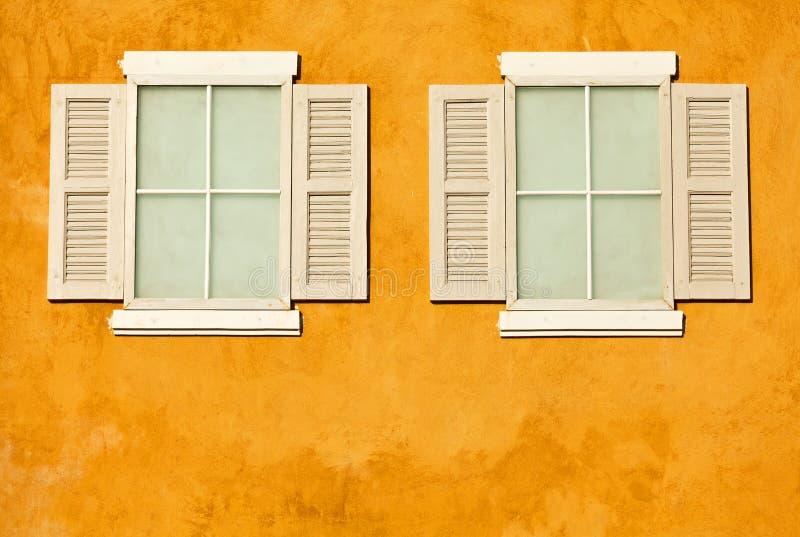 White wood windows on wall stock photos