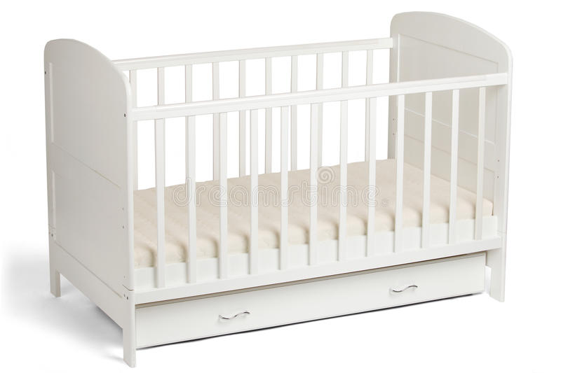 White wooden baby crib on white background royalty free stock photography