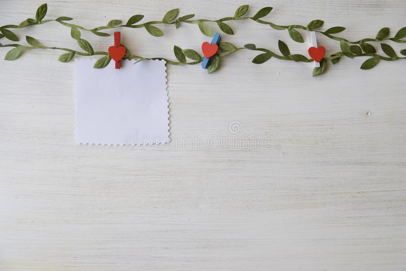 Download White Wooden Background With Green Leaves Stock Photo - Image: 83704963
