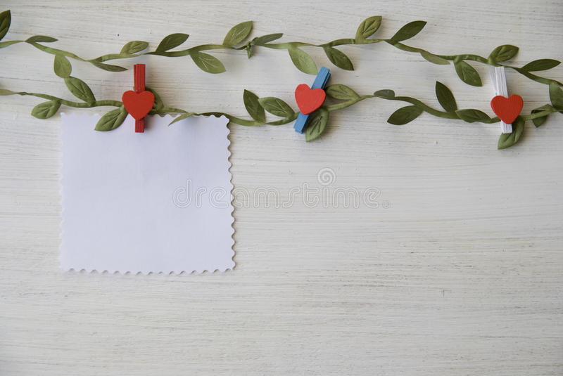 Download White Wooden Background With Green Leaves Stock Photo - Image: 83704756