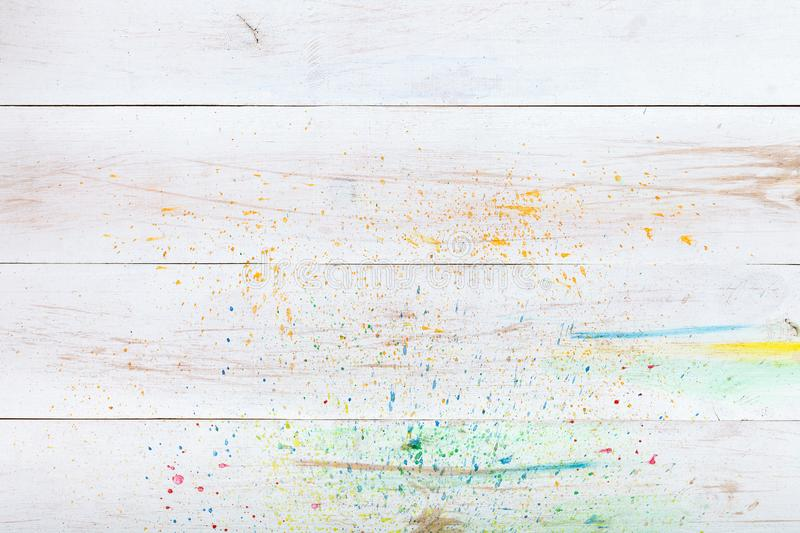 White wooden background with paint splashes, creative wood blank empty table desk plank board. Watercolor artist backdrop, art stock photo