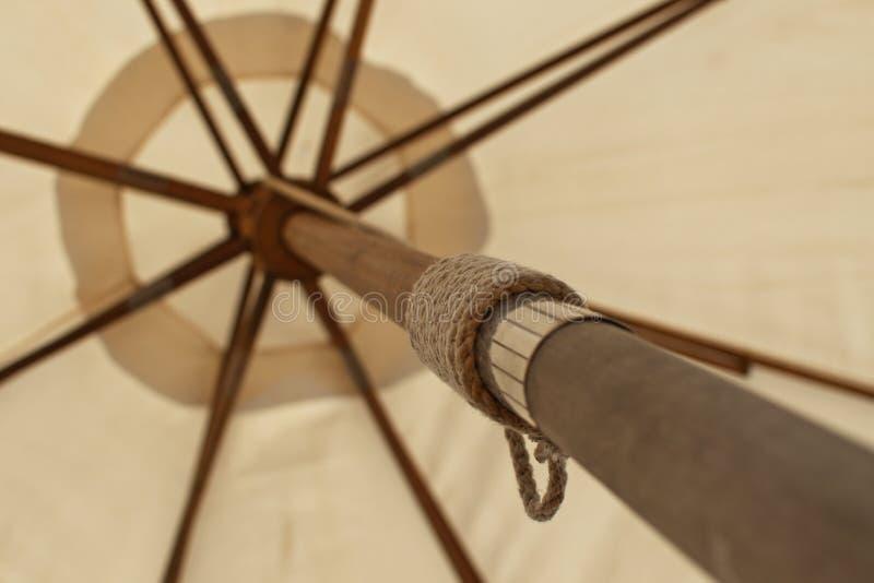 Wooden beach umbrella close-up bottom angle royalty free stock photos