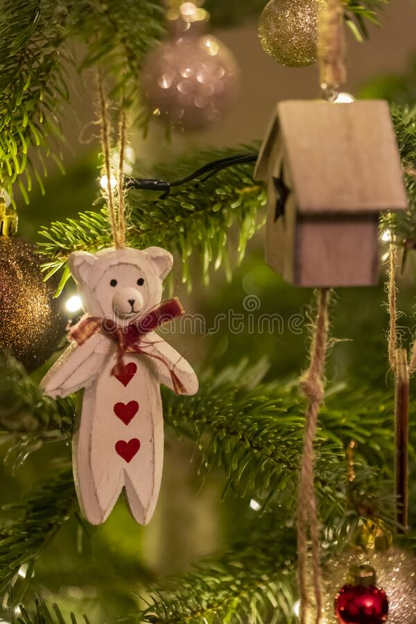 White Wooden Bear Shaped Christmas Tree Decoration. A White Wooden Bear Shaped Christmas Tree Decoration Close Up Hanging From A Tree stock photos