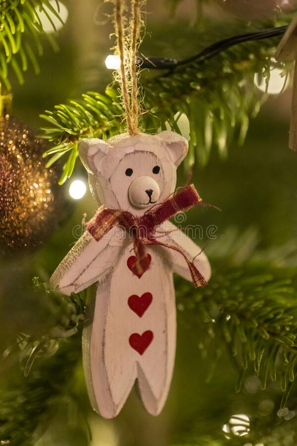 White Wooden Bear Shaped Christmas Tree Decoration. A White Wooden Bear Shaped Christmas Tree Decoration Suspended from a Tree Close Up royalty free stock photo