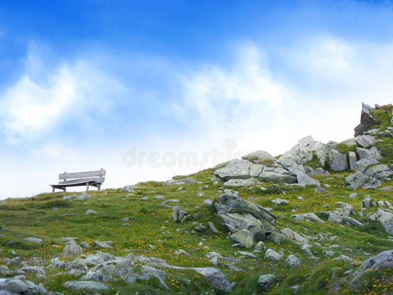 White Wooden Bench in Mountain during Daytime stock image