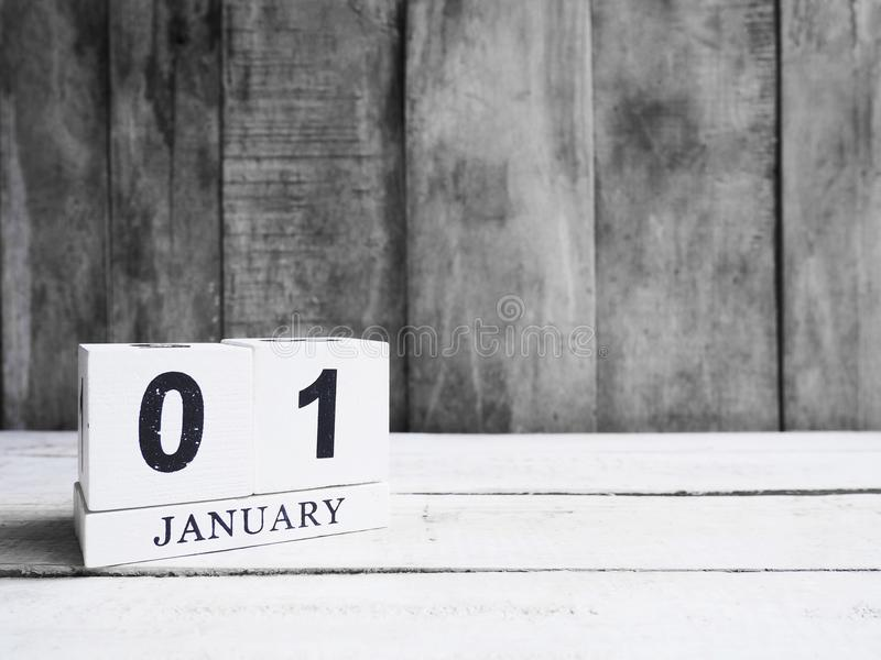 White wooden block calendar show date 01 and month January on wood background stock photography