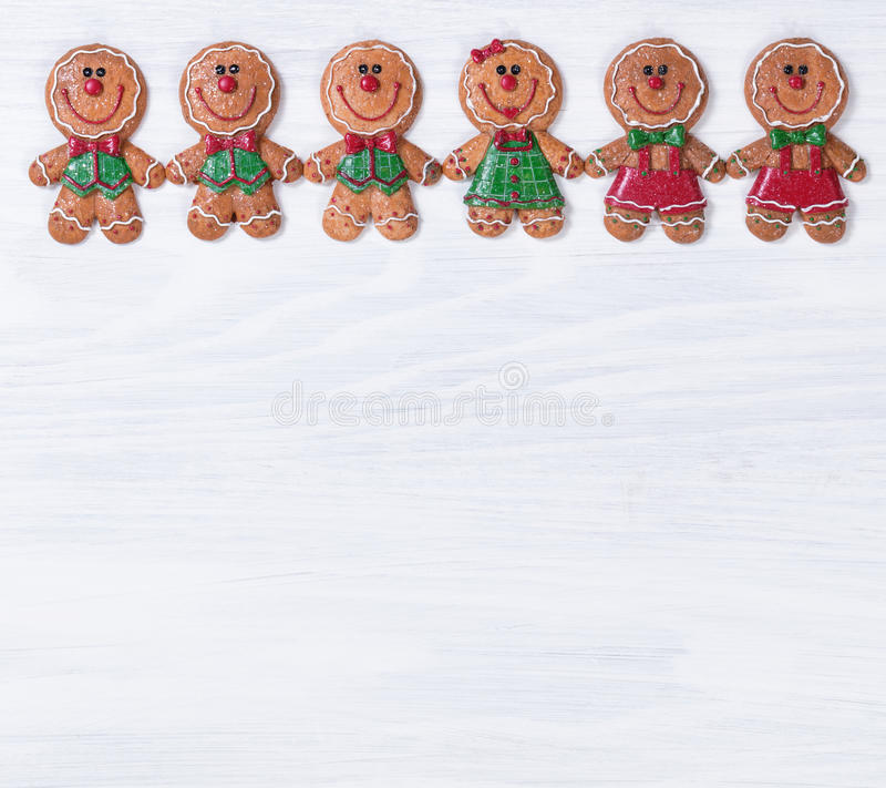 White wooden boards with Christmas cookies on upper border. Top border of Christmas holiday cookies on white wood royalty free stock photos