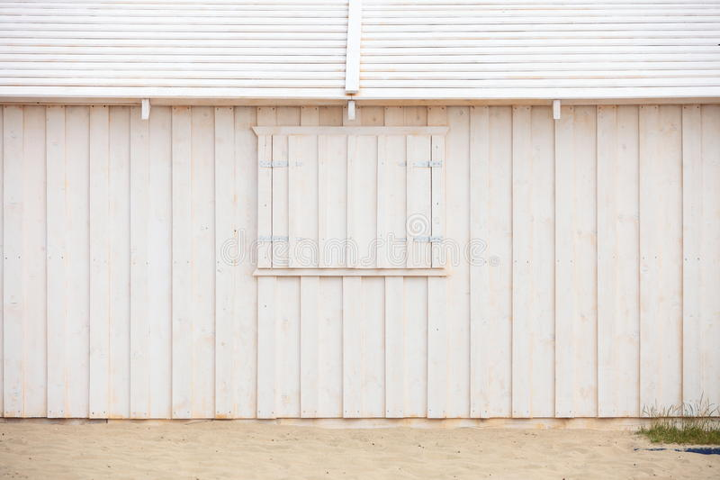 White wooden building wall on beach stock photos