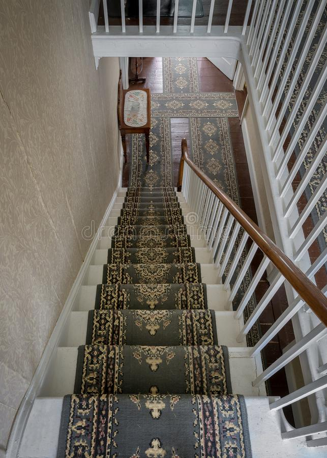 White wooden carpeted residential staircase royalty free stock photo
