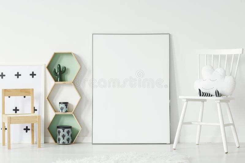 White and wooden chair in kid`s room interior with mockup of emp royalty free stock photo