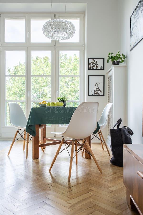 White wooden chairs around kitchen table stock photos