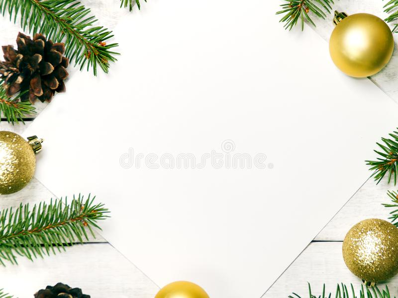 White wooden Christmas background. Border decorated fir branches and pin cones. Copy space for holiday greetings. lovely. White wooden Christmas background royalty free stock photos