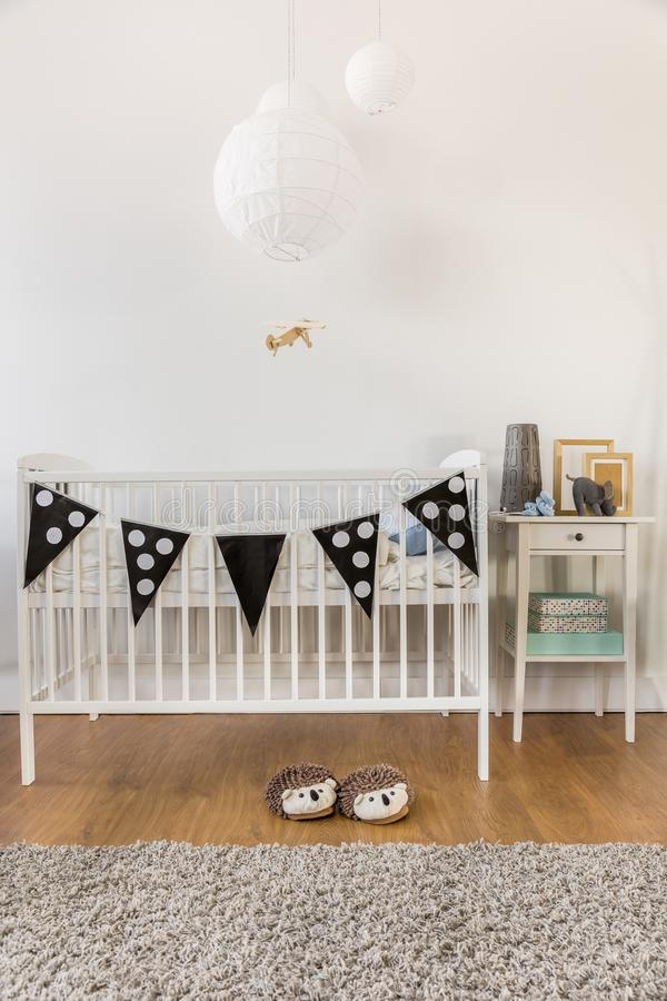 White wooden crib. Photo of white wooden crib in kid room stock photo