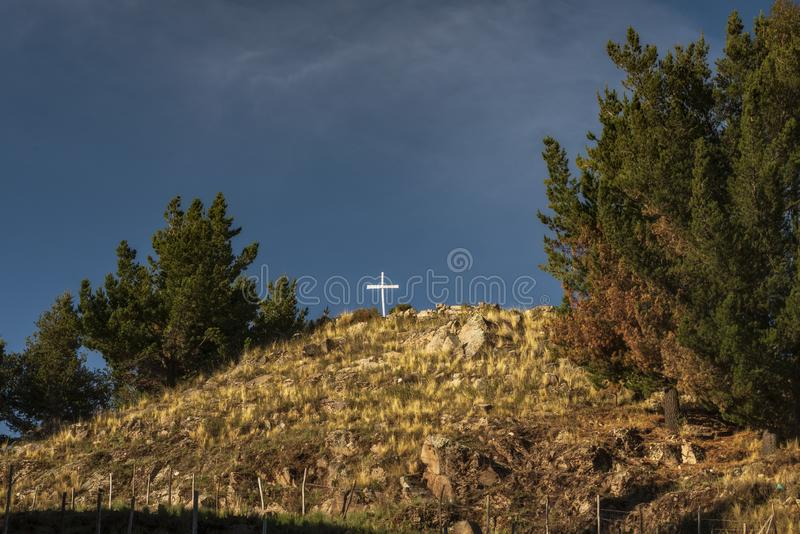 White cross on hilltop stock photography