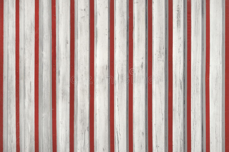 White wooden facade with fitted red slats royalty free stock image