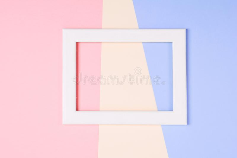 White wooden frame over pastel colorful paper background stock photos