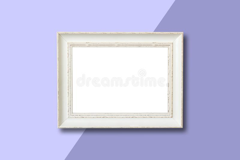 White wooden frame on purple background. royalty free stock image