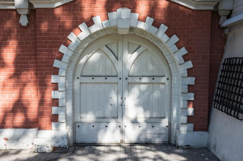 White wooden gate in Petrovsky travelling palace in Moscow Petrovsky travelling palace in Moscow. Neoghotic red bricked architecture stock photography