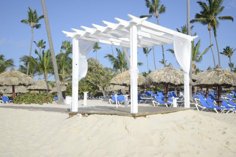 White wooden gazebo on a beach royalty free stock photography