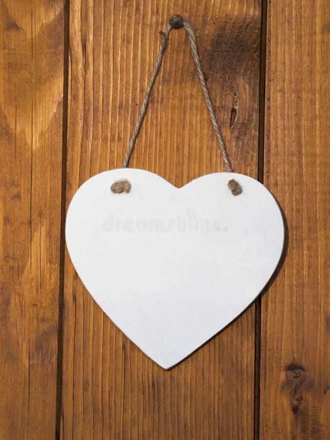 White wooden heart stock photo