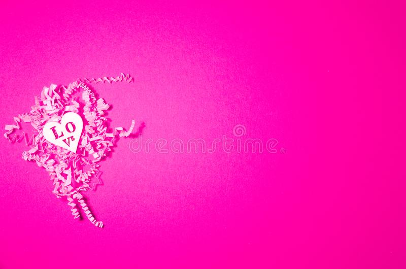 White wooden herarts on the pink sliced paper background. Valentines day collage stock photo