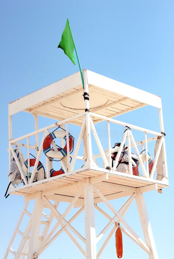 White wooden lifeguard tower on the beach stock image