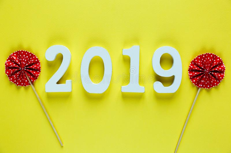 White wooden Numbers 2019 on yellow background. creative Christmas and New year background, decoration. Postcard stock photo