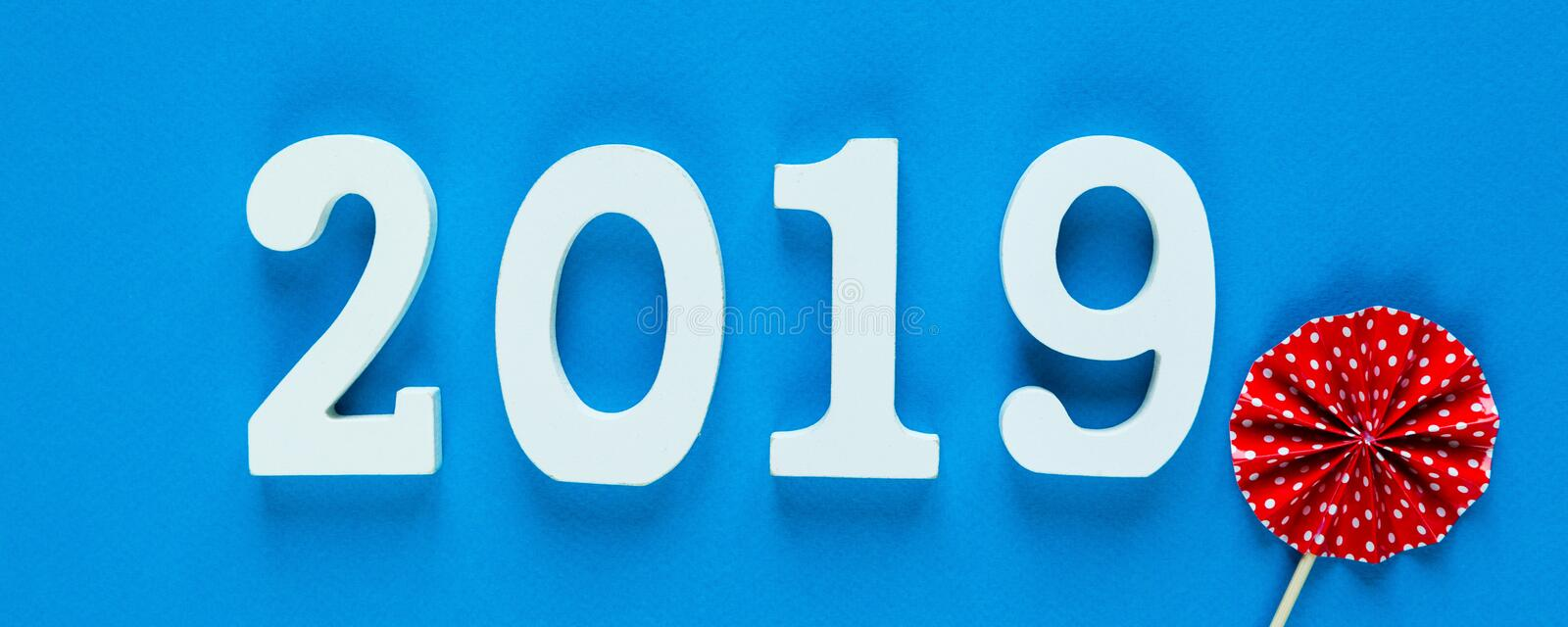 White wooden Numbers 2019 on yellow background. creative Christmas and New year background, decoration,. White wooden Numbers 2019 on blue background. creative royalty free stock image