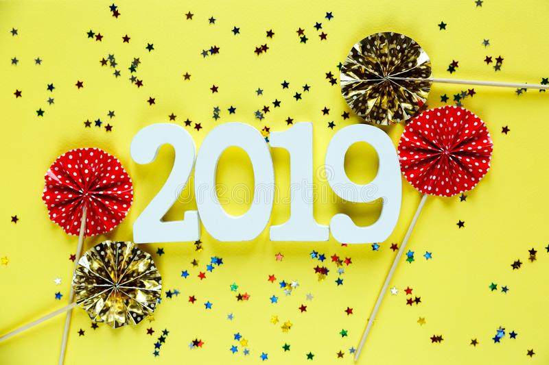 White wooden Numbers 2019 on yellow background. creative Christmas and New year background, decoration. Postcard concept stock photo