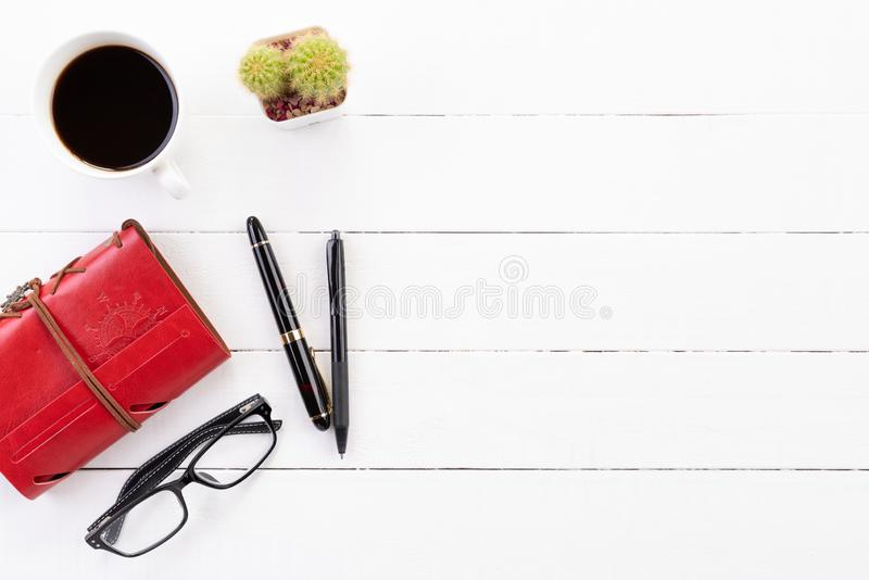 White wooden office desk table with blank notebook, calculator, coffee cup and other office supplies. Top view with copy space, stock photos