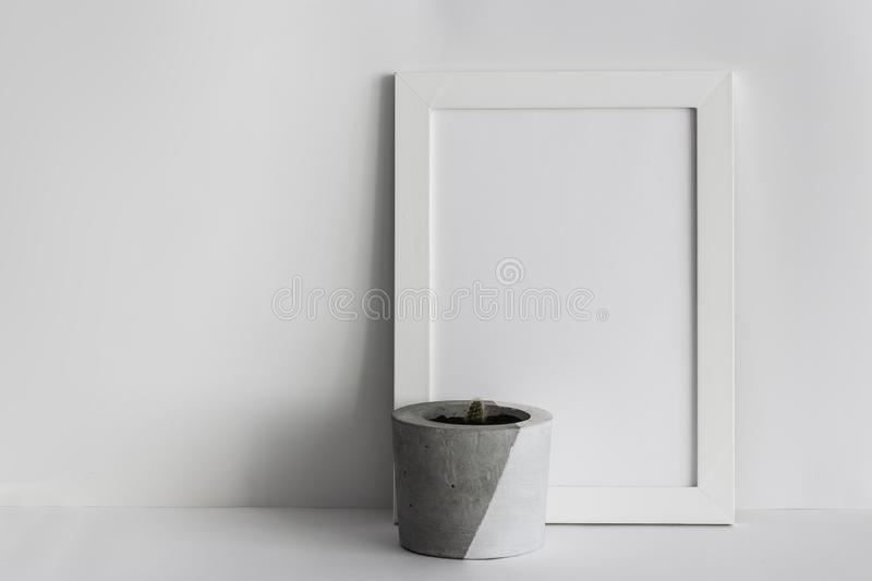 White wooden photo frame with potted cactus stock photo