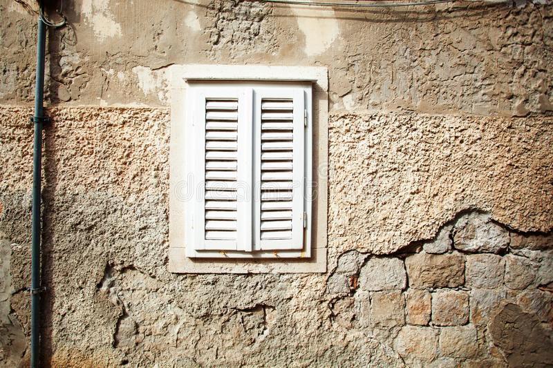 White wooden shutters closeup. May use as background. Window architecture building house home decoration design texture vintage wall closed light rustic stock image