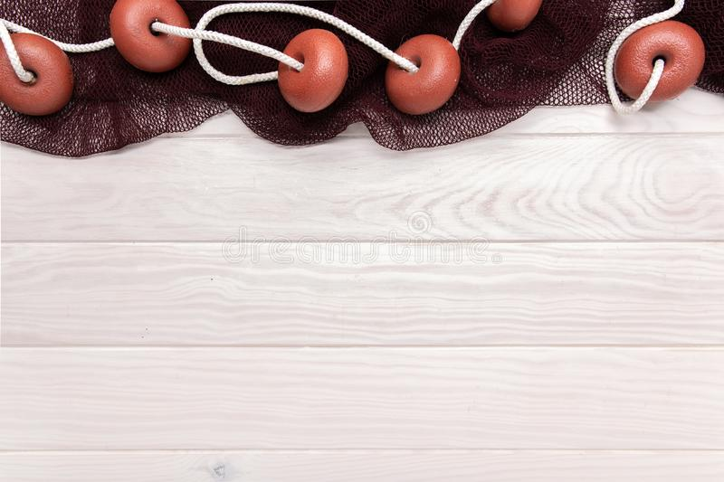 Marine background with wooden table and fishing nets. Copy space stock image