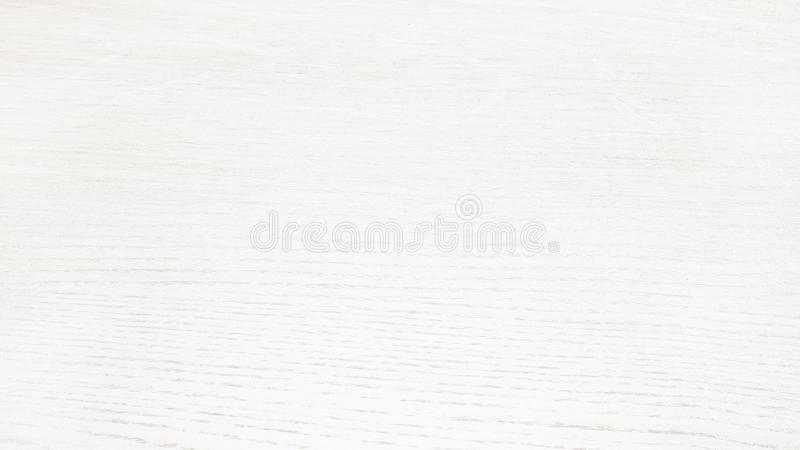 White wooden table surface - light wood background. White wooden table close-up surface. Light wood background stock photography