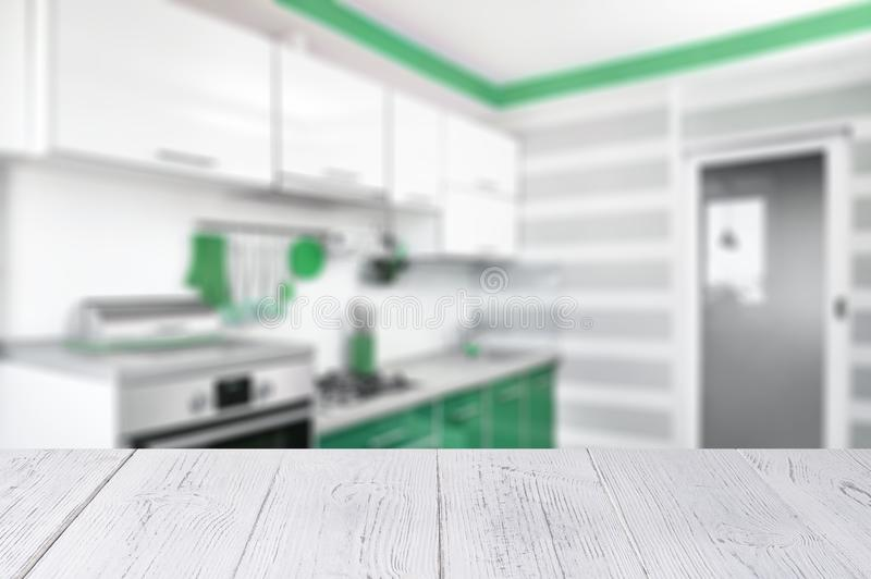 White wooden table top and kitchen interior in neo mint trendy colours. Color of the 2020 year royalty free stock photography