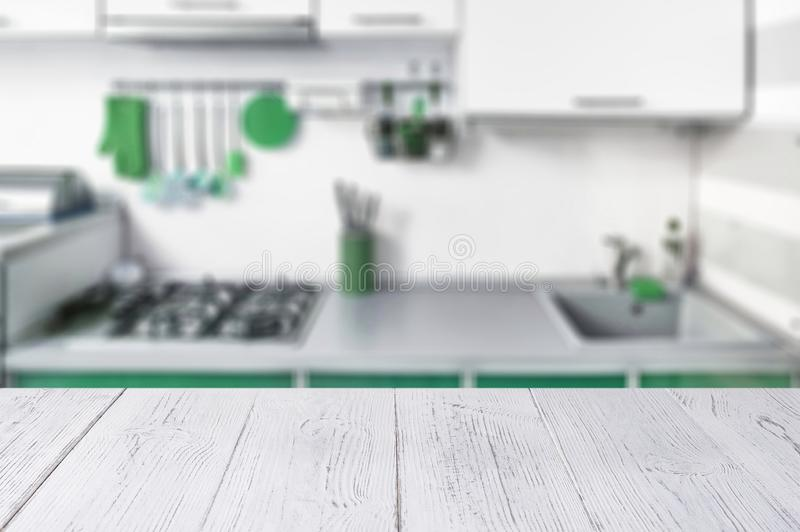 White wooden table top and kitchen interior in neo mint trendy colours. Color of the 2020 year stock photo