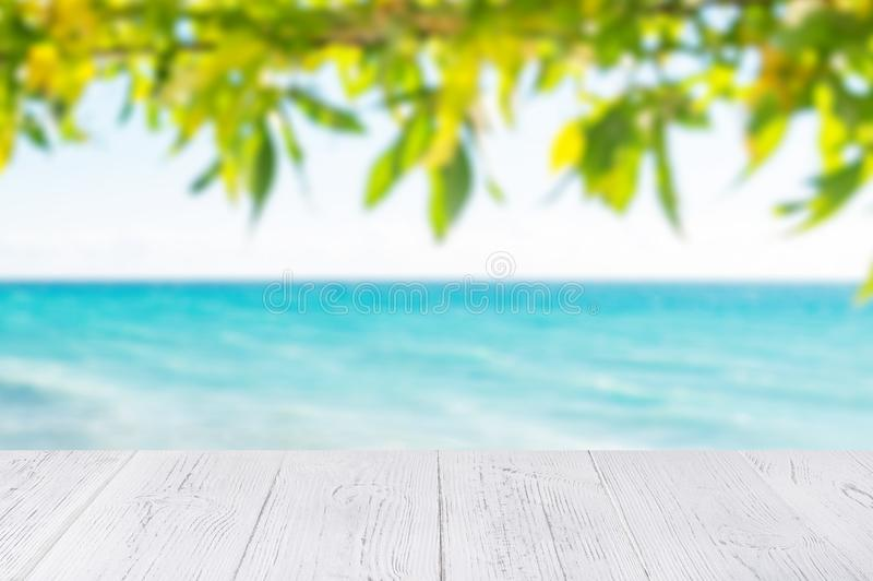 White wooden table top at ocean beach background. 2020 island vacation concept with copy space.  stock image