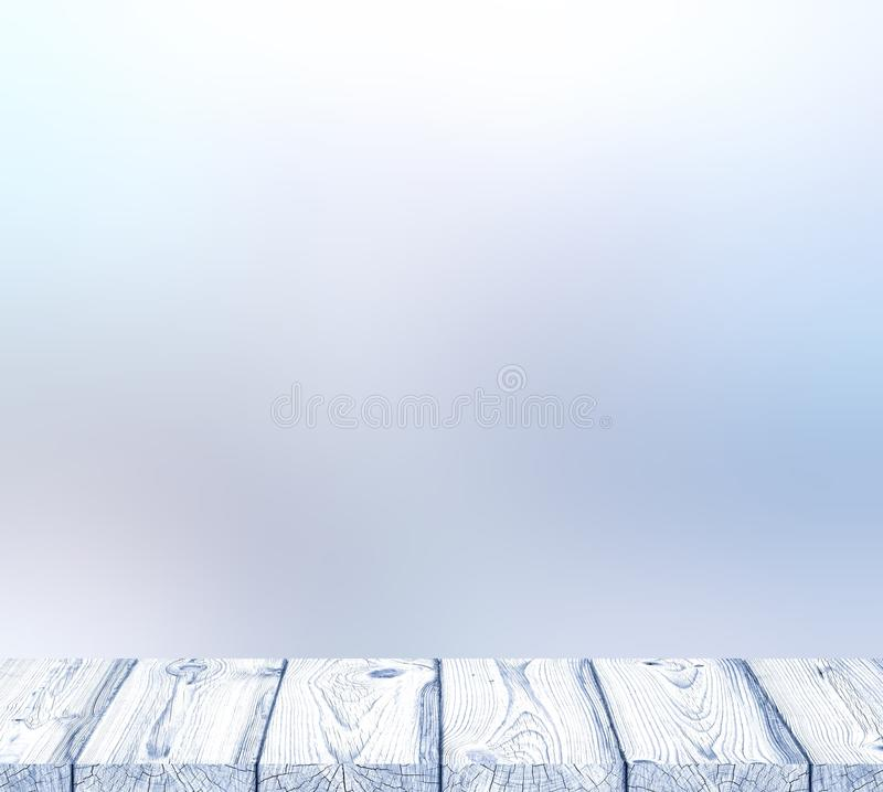 White wooden table with winter place and Christmas pale blurred background royalty free stock photos