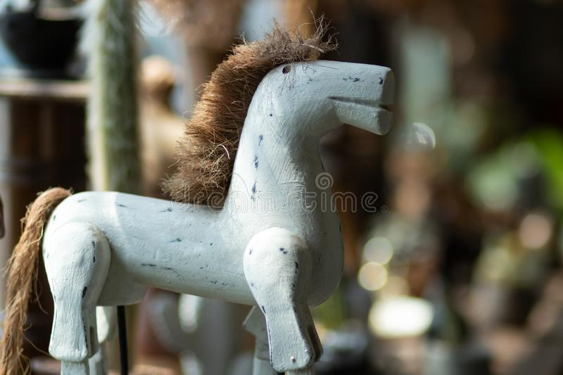 The white wooden toy horse in front of defocused things. royalty free stock image