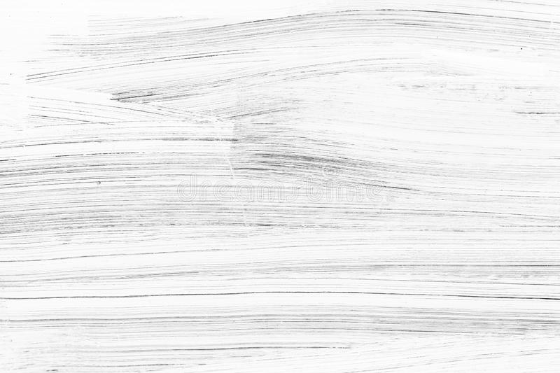 White wooden wall with paint brush strokes royalty free stock photos
