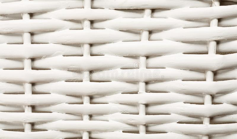 White wooden wicker basket fragment abstract texture. Background, pattern, weave, closeup, detail, mesh, woven, backdrop, craft, material, surface, textured stock image