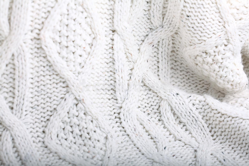 White wool knit sweater. Texture of white wool knit sweater stock images