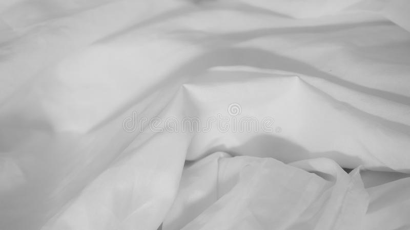 White wrinkled fabric background stock photo