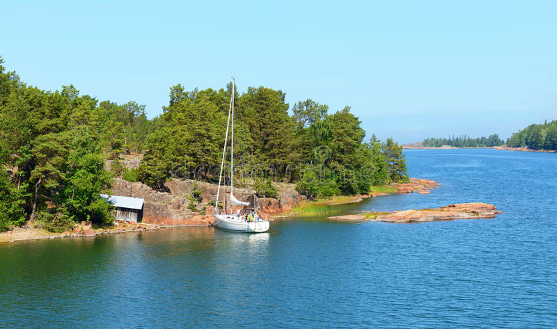 White yacht in the blue lagoon. Aland Islands royalty free stock image