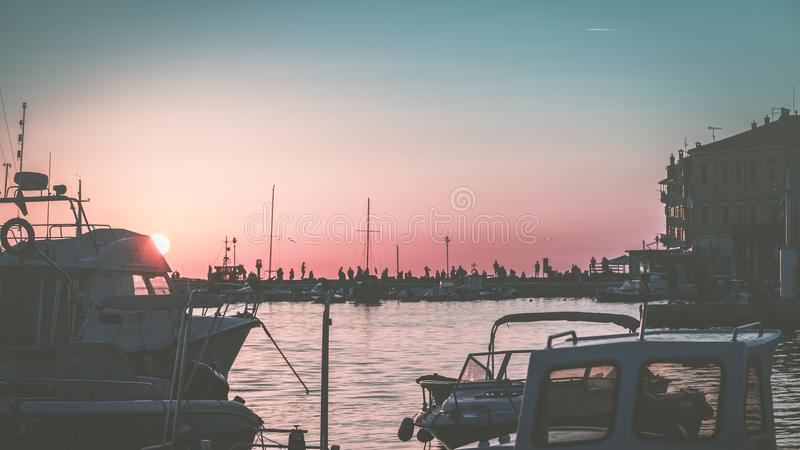 White Yacht on Body of Water during Sunset royalty free stock photography