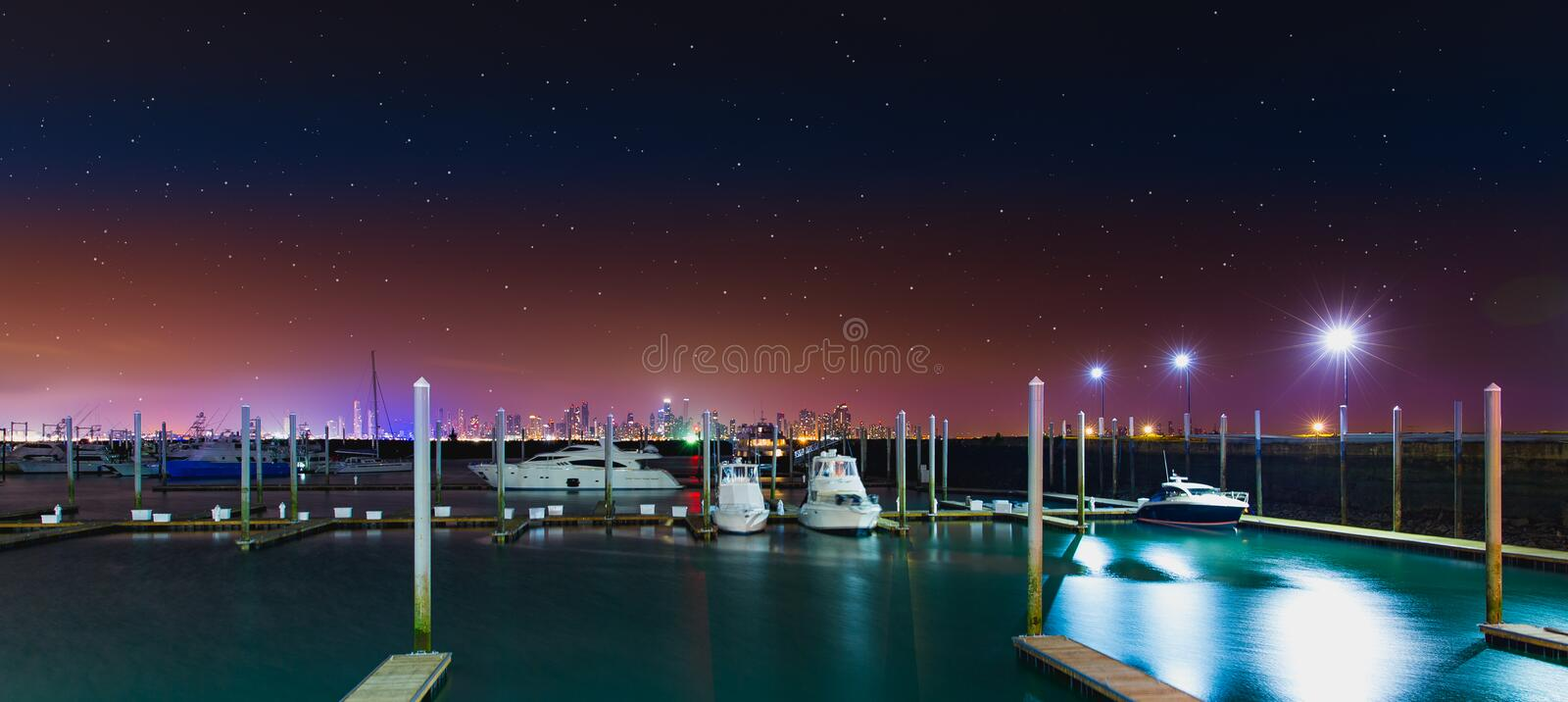 White Yacht at the Dock during Nighttime stock photos