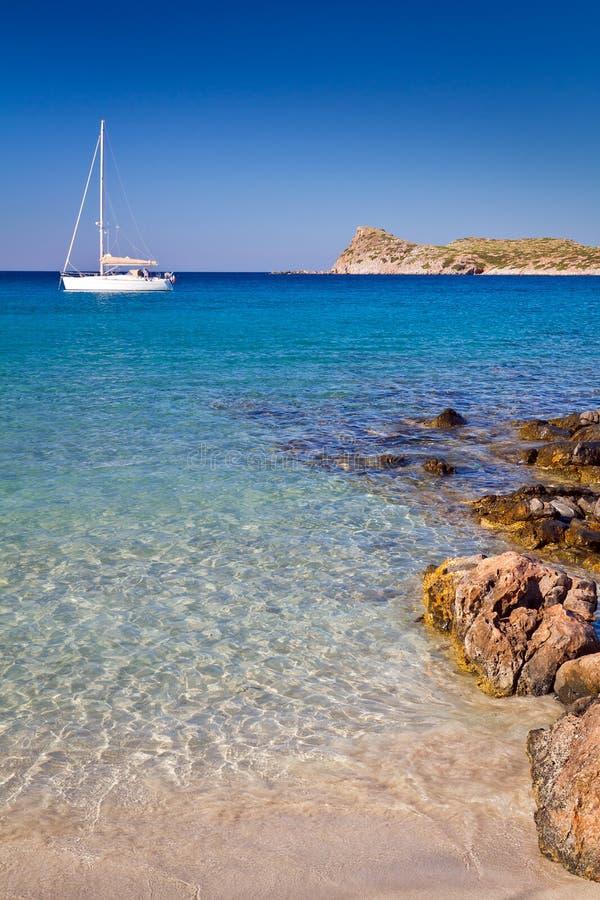 White yacht on the idyllic lagoon stock photo
