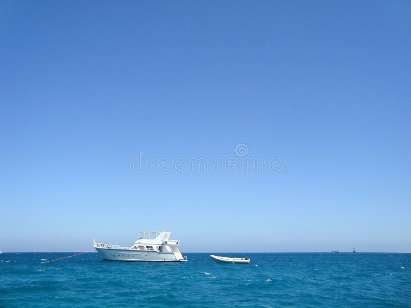 White yacht in the open sea. stock photo