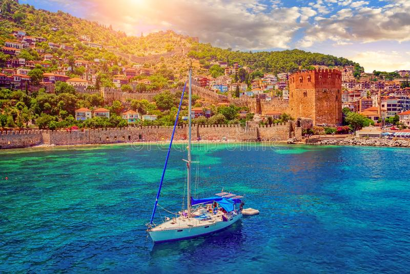 White yacht in the sea bay. Harbor of the Red Tower Alanya, Turkey stock image